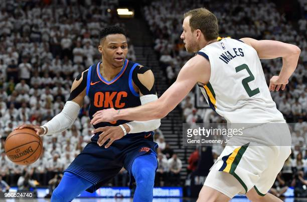 Russell Westbrook of the Oklahoma City Thunder tries to drive past the defense of Joe Ingles of the Utah Jazz in the second half during Game Four of...