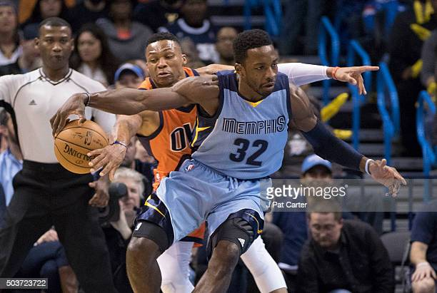 Russell Westbrook of the Oklahoma City Thunder tries to steal the ball from Jeff Green of the Memphis Grizzlies looks for a play during the first...
