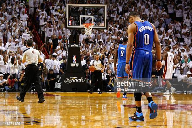 Russell Westbrook of the Oklahoma City Thunder walks up court with his head down late in the fourth quarter against the Miami Heat in Game Four of...