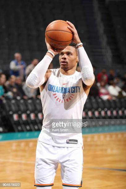 Russell Westbrook of the Oklahoma City Thunder warms up before the game against the Charlotte Hornets on January 13 2018 at Spectrum Center in...