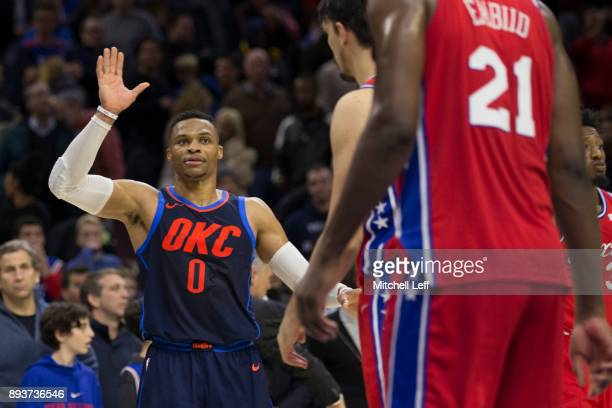Russell Westbrook of the Oklahoma City Thunder waves goodbye to Joel Embiid of the Philadelphia 76ers after the game at the Wells Fargo Center on...