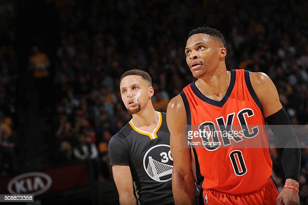 Russell Westbrook of the Oklahoma City Thundera and Stephen Curry of the Golden State Warriors during the game on February 6 2016 at ORACLE Arena in...