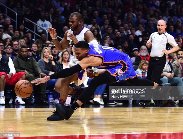 Russell Westbrook of the Oklahoma Cty Thinder attempts a steal of the basketball from Chris Paul of the LA Clippers at Staples Center on January 16...
