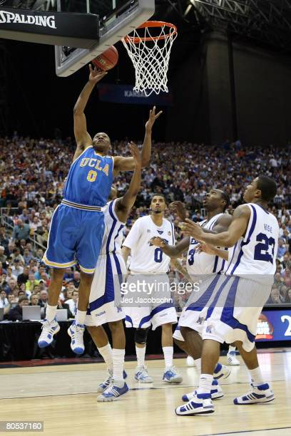 Russell Westbrook of the UCLA Bruins lays the ball up against four Memphis Tigers defenders during the National Semifinal game of the NCAA Men's...