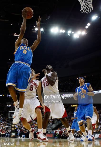 Russell Westbrook of the UCLA Bruins shoots over James Gist and Eric Hayes of the Maryland Terrapins during the O'Reilly Auto Parts CBE Classic...