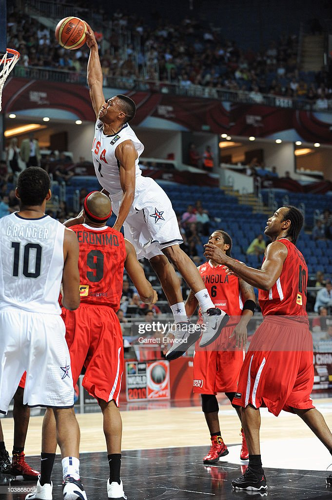 Russell Westbrook #7 of the USA Senior Men's National Team goes to the basket over Vladamir Jeronimo #9, Carlos Morais #6 and Joaquim Gomes #10 of Angola during the 2010 World Championships of Basketball on September 6, 2010 at the Sinan Erdem Dome in Istanbul, Turkey.