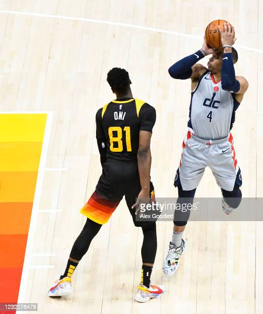 Russell Westbrook of the Washington Wizards draws a foul against Miye Oni of the Utah Jazz during a game at Vivint Smart Home Arena on April 12, 2021...