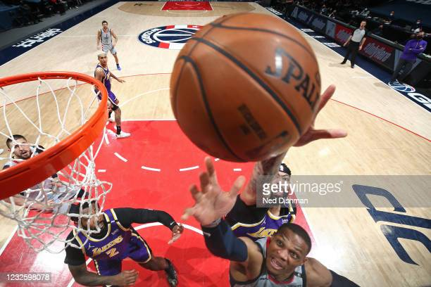 Russell Westbrook of the Washington Wizards drives to the basket around Anthony Davis of the Los Angeles Lakers on April 28, 2021 at Capital One...