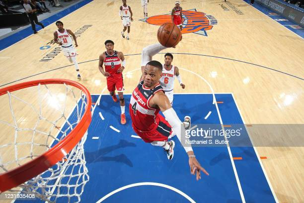 Russell Westbrook of the Washington Wizards dunks the ball against the New York Knicks on March 25, 2021 at Madison Square Garden in New York City,...