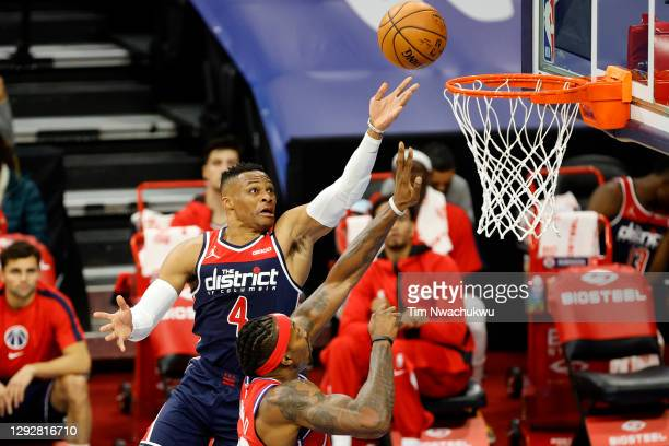 Russell Westbrook of the Washington Wizards elevates for a lay up over Dwight Howard of the Philadelphia 76ers during the first quarter at Wells...