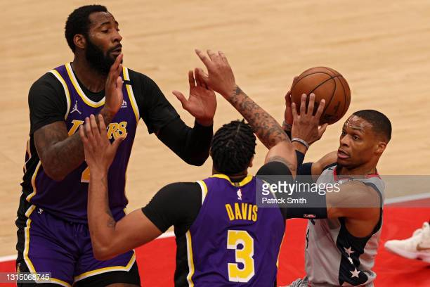 Russell Westbrook of the Washington Wizards looks to shoot in front of Andre Drummond and Anthony Davis of the Los Angeles Lakers during the first...
