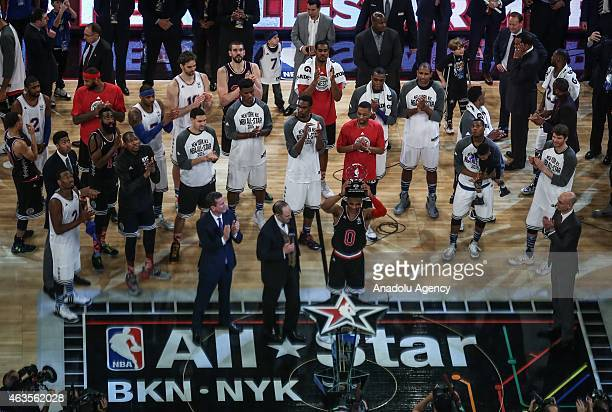 Russell Westbrook of the Western Conference AllStar Team is presented with the Kia NBA AllStar Game MVP trophy during the 64th NBA AllStar Game...