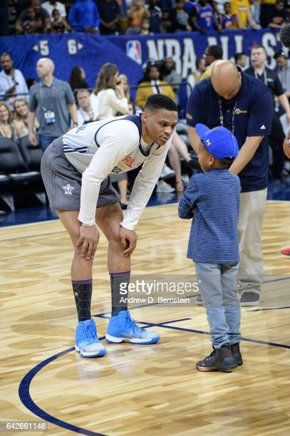 Russell Westbrook of the Western Conference AllStar Team talks to a young fan during the 2017 NBA AllStar Practice as part of 2017 AllStar Weekend at...