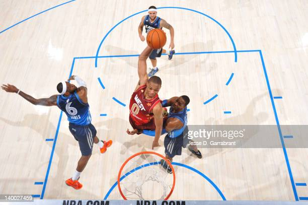Russell Westbrook of the Western Conference AllStars dunks against LeBron James and Dwight Howard of the Eastern Conference AllStars during the 2012...