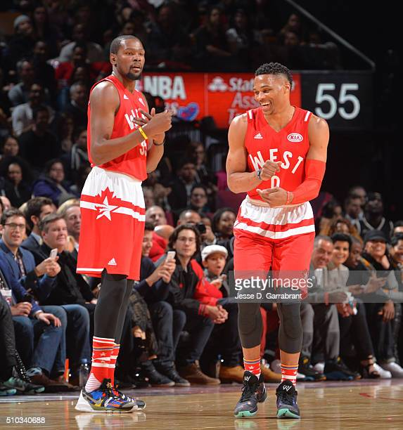 Russell Westbrook of the Western Conference AllStars smiles alongside Kevin Durant during the NBA AllStar Game as part of the 2016 NBA All Star...