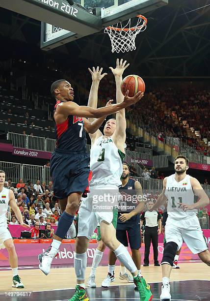 Russell Westbrook of United States lays up a shot against past Jonas Maciulis of Lithuania during the Men's Basketball Preliminary Round match on Day...