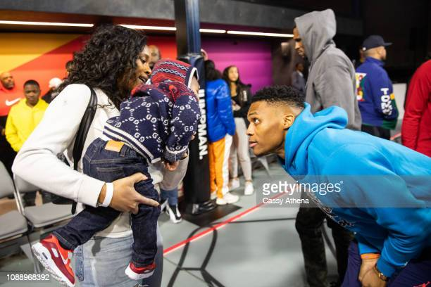 Russell Westbrook talks with wife Nina Westbrook and son Noah Westbrook at his Why Not Zer02 sneaker launch on January 01 2019 in Los Angeles...