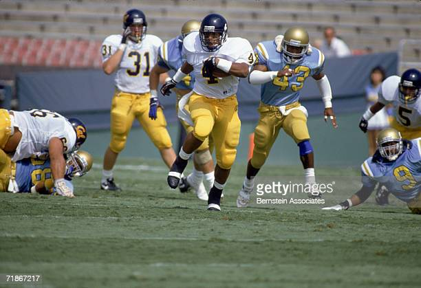 Russell White of the University of California Golden Bears carries the ball against the University of California at Los Angeles Bruins during the...
