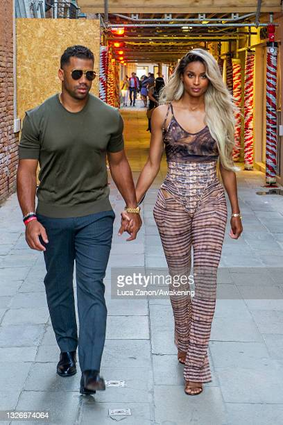 Russell Wilson and Ciara arrive at the Harry's Bar for a dinner on July 02, 2021 in Venice, Italy.