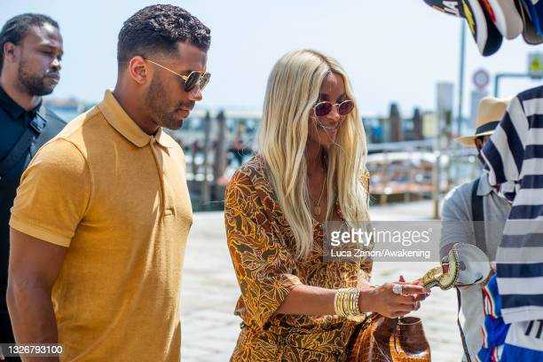 Russell Wilson and Ciara arrive at the Resturant Al Corvo on July 03, 2021 in Venice, Italy.