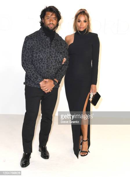 Russell Wilson and Ciara arrives at the Tom Ford AW20 Show at Milk Studios on February 07 2020 in Hollywood California