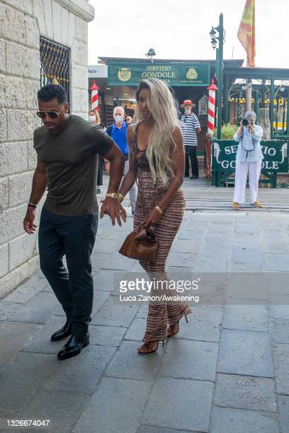 Russell Wilson and Ciara entry at the Harry's Bar for a dinner on July 02, 2021 in Venice, Italy.