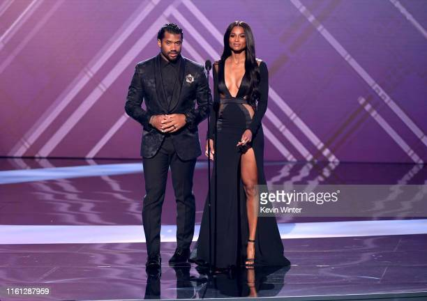 Russell Wilson and Ciara speak onstage during The 2019 ESPYs at Microsoft Theater on July 10 2019 in Los Angeles California