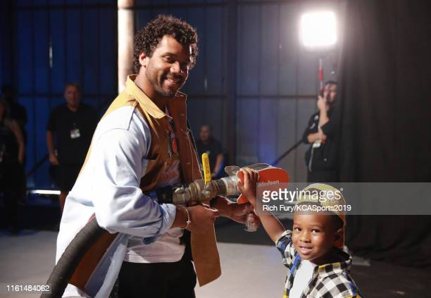 Russell Wilson and Future Zahir Wilburn prepare to slime Ciara backstage at Nickelodeon Kids' Choice Sports 2019 at Barker Hangar on July 11 2019 in...