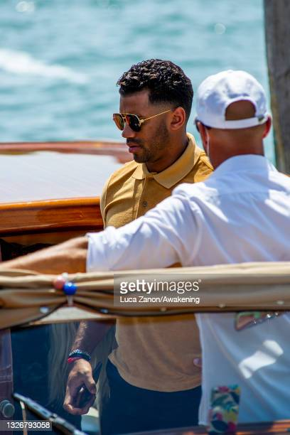 Russell Wilson arrives at the Resturant Al Corvo with Ciara on July 03, 2021 in Venice, Italy.