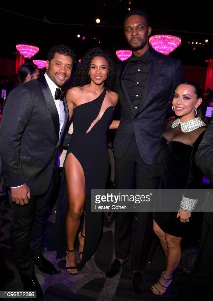 Russell Wilson Ciara Chris Bosh and Adrienne Williams Bosh attend the PreGRAMMY Gala and GRAMMY Salute to Industry Icons Honoring Clarence Avant at...