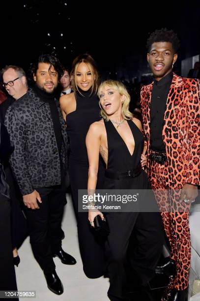 Russell Wilson Ciara Miley Cyrus and Lil Nas X attend Tom Ford Autumn/Winter 2020 Runway Show at Milk Studios on February 07 2020 in Los Angeles...
