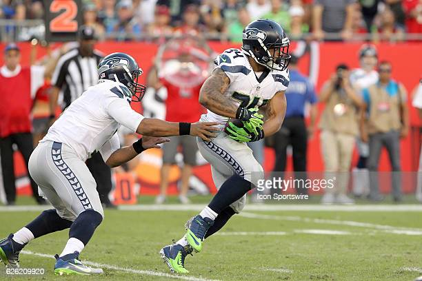 Russell Wilson hands the ball off to Thomas Rawls of the Seahawks during the NFL Game between the Seattle Seahawks and Tampa Bay Buccaneers on...