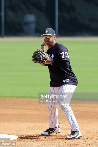 Russell Wilson makes the throw over to first base to complete the double play during the New York Yankees spring training workout on March 01 at...