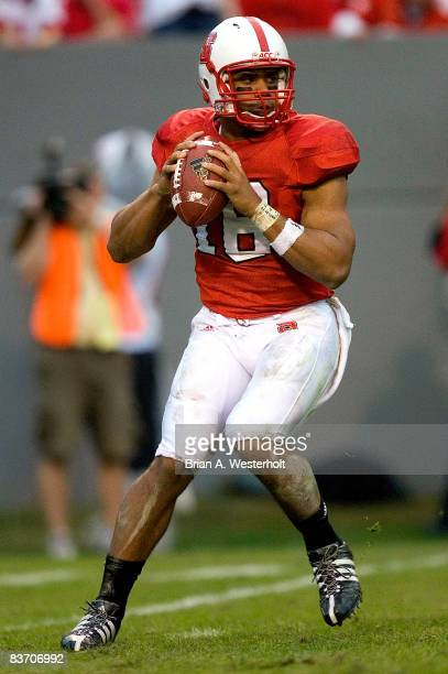 Russell Wilson of the North Carolina State Wolfpack drops back to pass during first half action versus the Wake Forest Demon Deacons at Carter Finley...
