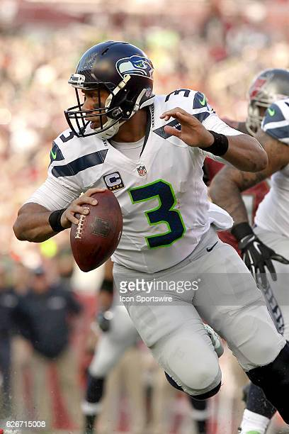 Russell Wilson of the Seahawks rolls out to the left during the NFL Game between the Seattle Seahawks and Tampa Bay Buccaneers on November 27 at...
