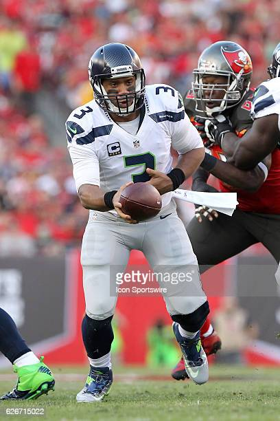 Russell Wilson of the Seahawks turns to hand the ball off to Thomas Rawls during the NFL Game between the Seattle Seahawks and Tampa Bay Buccaneers...