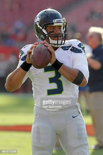 Russell Wilson of the Seahawks warms up before the NFL Game between the Seattle Seahawks and Tampa Bay Buccaneers on November 27 at Raymond James...