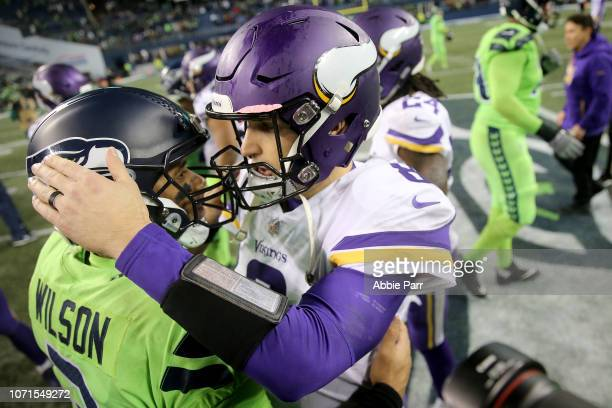 Russell Wilson of the Seattle Seahawks and Kirk Cousins of the Minnesota Vikings hug after the Seattle Seahawks defeated the Minnesota Vikings 21-0...