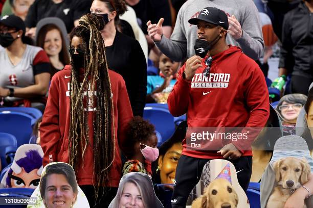 Russell Wilson of the Seattle Seahawks and musician Ciara Wilson watch during the third quarter between the South Carolina Gamecocks and the Stanford...