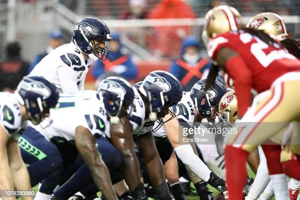 Russell Wilson of the Seattle Seahawks calls the snap count against the San Francisco 49ers during their NFL game at Levi's Stadium on December 16,...