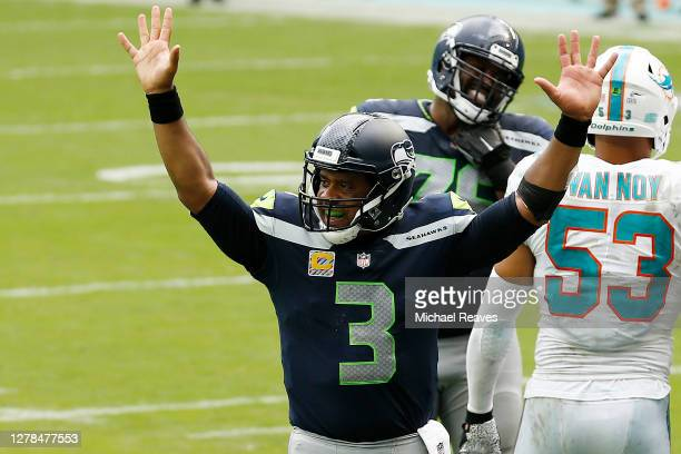 Russell Wilson of the Seattle Seahawks celebrates after a touchdown against the Miami Dolphins during the fourth quarter at Hard Rock Stadium on...