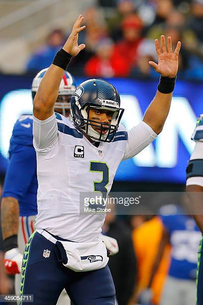 Russell Wilson of the Seattle Seahawks celebrates after throwing a touchdown against the New York Giants at MetLife Stadium on December 15 2013 in...
