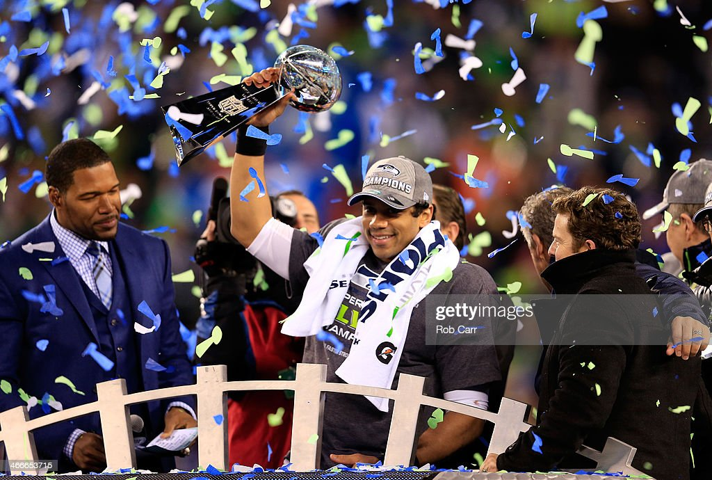 Russell Wilson #3 of the Seattle Seahawks celebrates with the Vince Lombardi trophy after defeating the Denver Broncos 43-8 in Super Bowl XLVIII at MetLife Stadium on February 2, 2014 in East Rutherford, New Jersey.