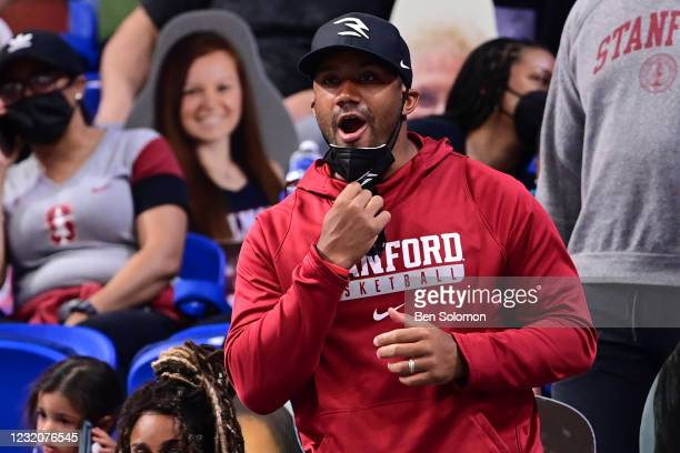 Russell Wilson of the Seattle Seahawks cheers for the Stanford Cardinal during their game against the South Carolina Gamecocks in the semifinals of...