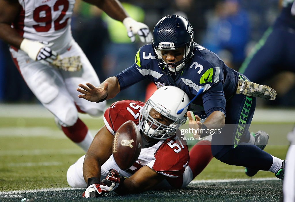 Russell Wilson #3 of the Seattle Seahawks fumbles the football for a safety during the second quarter against the Arizona Cardinals at CenturyLink Field on November 15, 2015 in Seattle, Washington.