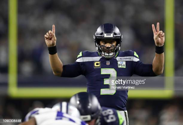 Russell Wilson of the Seattle Seahawks gestures before a play in the third quarter against the Dallas Cowboys during the Wild Card Round at ATT...