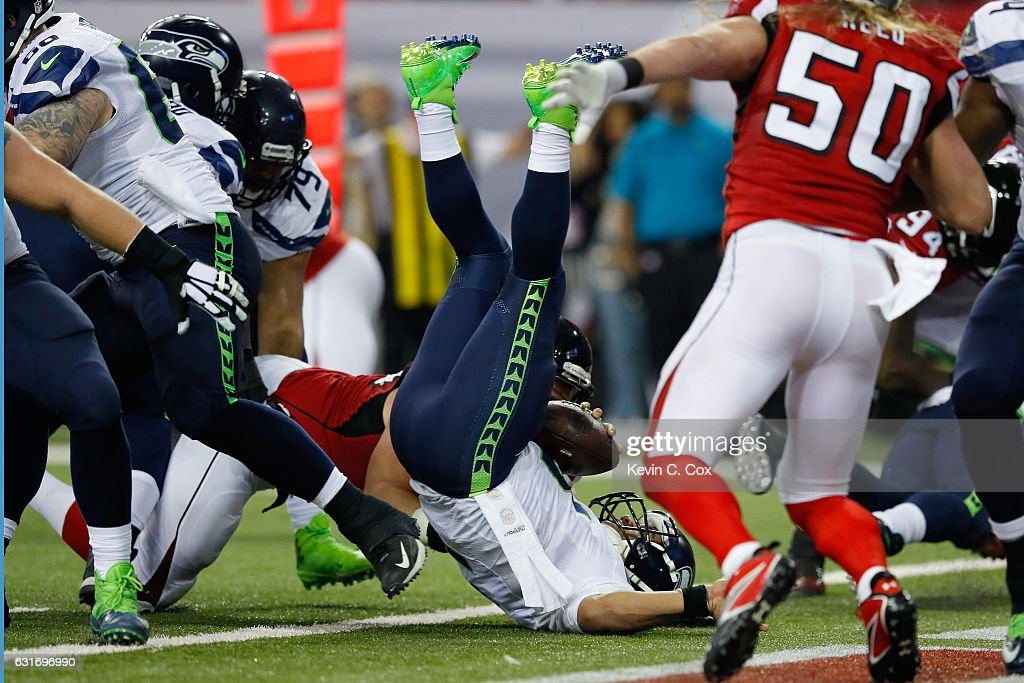 Russell Wilson #3 of the Seattle Seahawks gets tackled for a safety against the Atlanta Falcons at the Georgia Dome on January 14, 2017 in Atlanta, Georgia.