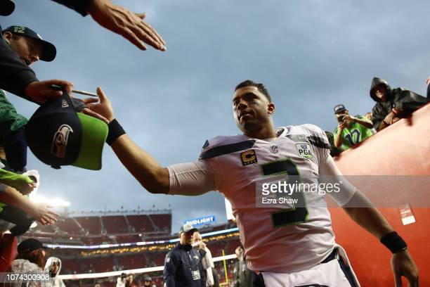 Russell Wilson of the Seattle Seahawks greets fans following their 26-23 loss to the San Francisco 49ers at Levi's Stadium on December 16, 2018 in...