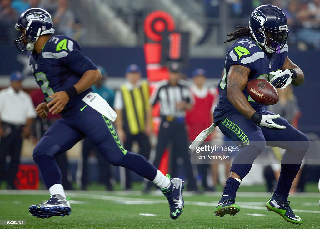 Russell Wilson #3 of the Seattle Seahawks hands the ball of off to Marshawn Lynch #24 of the Seattle Seahawks in the second half against the Dallas Cowboys at AT&T Stadium on November 1, 2015 in Arlington, Texas.