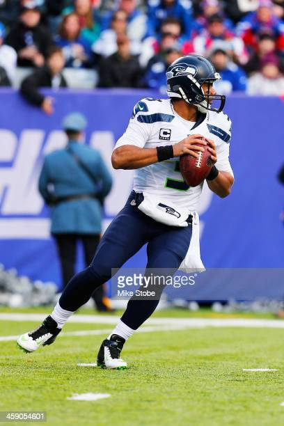 Russell Wilson of the Seattle Seahawks in acation against the Seattle Seahawks at MetLife Stadium on December 15 2013 in East Rutherford New Jersey...